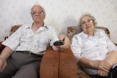 Senior Couple Watching TV At Home Royalty Free Stock Image
