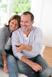 Senior couple watching tv at home. Senior couple watching televion at home Stock Image