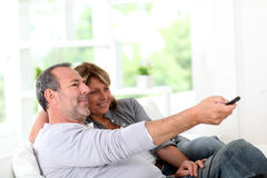 Senior couple watching tv at home Stock Photography