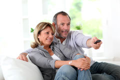 Senior couple watching tv. Senior couple watching television at home Stock Images