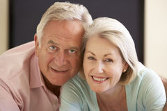 Senior Couple Watching Widescreen TV At Home Royalty Free Stock Images