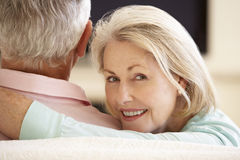 Senior Couple Watching Widescreen TV At Home Royalty Free Stock Photography