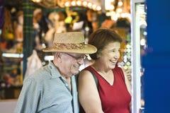 Senior Couple Watching Window Display. Happy senior couple watching window display Stock Photos