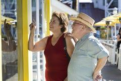 Senior Couple Watching Window Displays Royalty Free Stock Photos