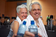 Senior couple with water bottles Royalty Free Stock Image