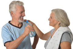 Senior couple  with water after exercising Stock Images