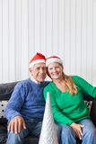 Senior couple wear red santa christmas hat present Royalty Free Stock Images