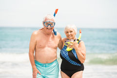 Senior couple wearing snorkel and diving goggles Royalty Free Stock Photography