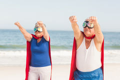 Senior couple wearing superman costume. On a sunny day royalty free stock images