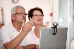 Senior couple and web camera Stock Photo