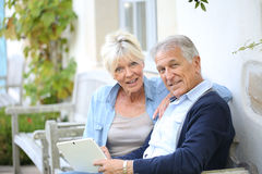 Senior couple websurfing on tablet Royalty Free Stock Image