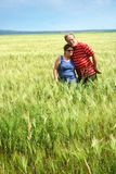 Senior couple in wheat field Royalty Free Stock Photos