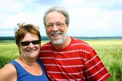 Senior couple in wheat field Royalty Free Stock Images