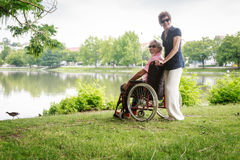 Senior Couple In Wheelchair stock images