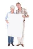 Senior couple with white board Stock Photo