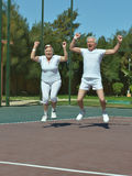 Senior couple win tennis Stock Photography