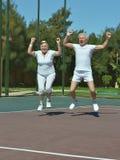 Senior couple win tennis Stock Photography