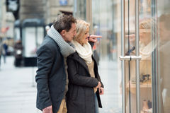 Senior couple window shopping in city centre. Winter Royalty Free Stock Photography