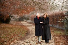 Senior Couple On Winter Walk Through Frosty Landsc Stock Photos