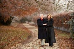 Senior Couple On Winter Walk Through Frosty Landsc. Ape Smiling Stock Photos