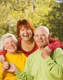 Senior Couple With Their Daughter Stock Images