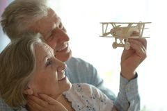 Senior couple with wooden plane Royalty Free Stock Photography