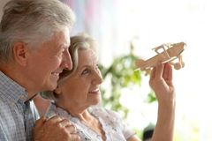 Senior couple with wooden plane Stock Image