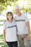 Senior Couple Working As Part Of Volunteer Group Royalty Free Stock Photos