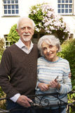 Senior Couple Working In Cottage Garden Stock Photos