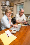 Senior couple working out their bills Royalty Free Stock Photos