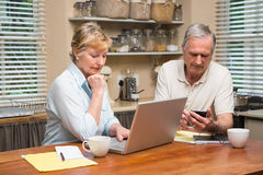 Senior couple working out their bills Royalty Free Stock Image