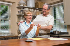 Senior couple working out their bills Royalty Free Stock Photo