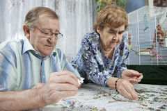 Senior couple working on a puzzle royalty free stock photography