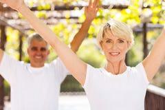 Senior couple workout. Healthy senior couple workout outdoors Royalty Free Stock Images