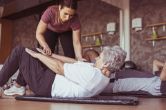 Senior couple workout in rehabilitation center. Royalty Free Stock Image