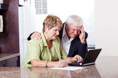 Senior couple worrying Royalty Free Stock Image