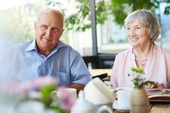 Senior couple wrapped in memories Stock Photo