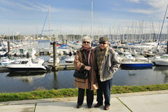 Senior couple at yacht harbor Stock Images