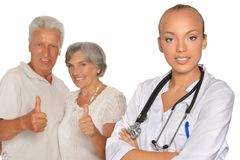 Senior Couple and young doctor Stock Photography