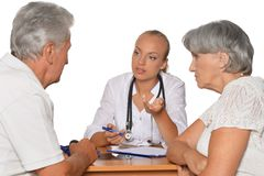 Senior Couple and young doctor Stock Image