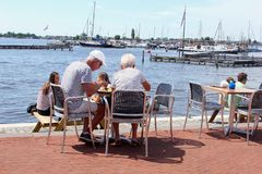 Senior couple young people terrace lake, Loosdrecht, Netherlands Stock Images