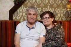Senior coupleposing on the sofa Royalty Free Stock Image