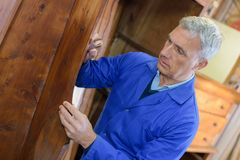 Senior craftman working on sculpture in workshop Royalty Free Stock Image