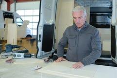 Senior craftsman at construction site royalty free stock photos