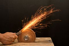 Senior craftsman hand grinding Royalty Free Stock Photo
