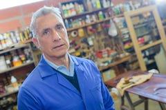 Senior craftsman in workshop Royalty Free Stock Image