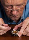 Senior craftsman repairing pocket watch Royalty Free Stock Photos