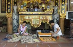 Senior craftsmen making printed painting artwork Royalty Free Stock Photo
