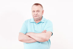 Senior with crossed arms Stock Images