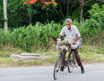 Senior Cuban Citizen Riding a Bike. SANTA CLARA,CUBA-JUNE 28,204: Senior Cuban citizen using a bicycle in Cuba where transportation is an issue and expensive for Stock Photography